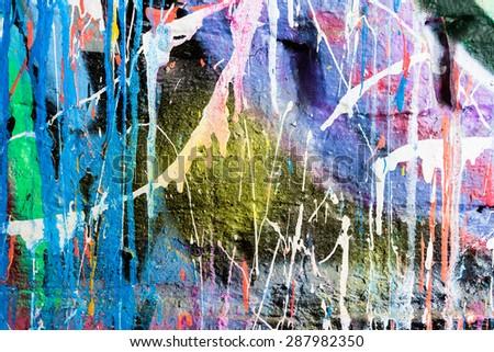 Dripping paint graffiti wall - stock photo