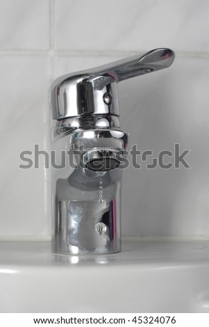 dripping water from tap - stock photo