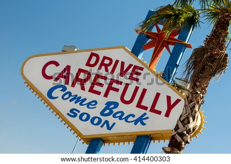 drive carefully, come back soon sign exiting Las Vegas, Nevada, USA