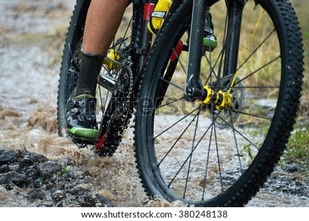 drive mountain bike over water river - stock photo