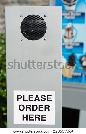 "Drive-Through Ordering Speaker With Sticker ""Please Order Here"" - stock photo"