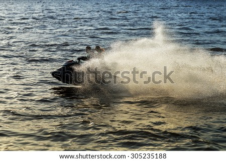drive water scooter on waters splashes  - stock photo