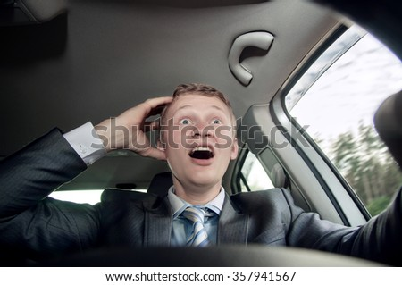 Driver behind the wheel of the car scared