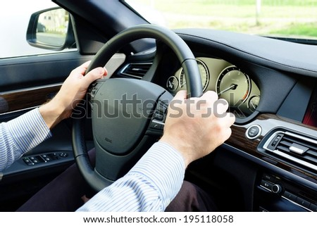 driver his hands on the wheel - stock photo