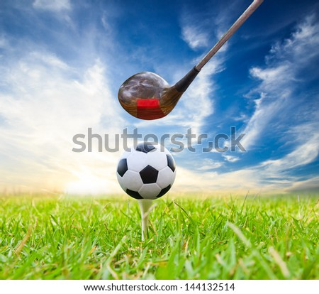 driver hit soccer ball on tee - stock photo