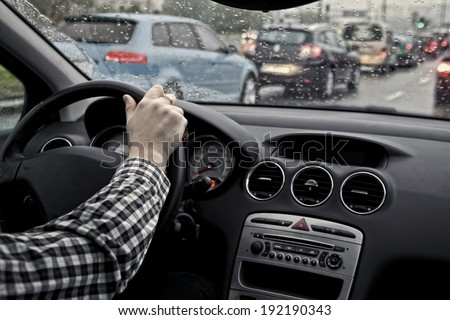 driver in traffic on a cloudy and rainy day