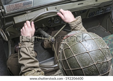 driver of a military vehicle of World War II with green helmet