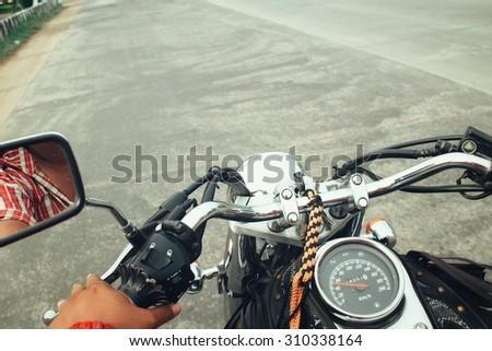 Driver riding motorcycle on the road