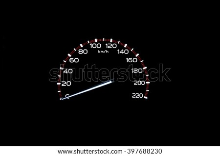 driver's cockpit ; speedometer on dashboard - white light in black, copy space for your design  - stock photo
