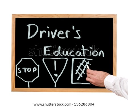 Driver's education is written in chalk on a chalkboard.