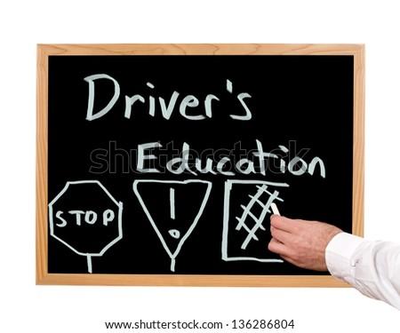 Driver's education is written in chalk on a chalkboard. - stock photo