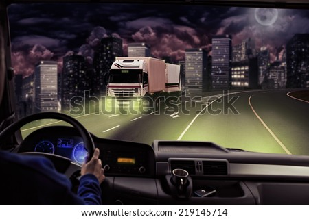 driver view from the cockpit of a truck on the road - stock photo