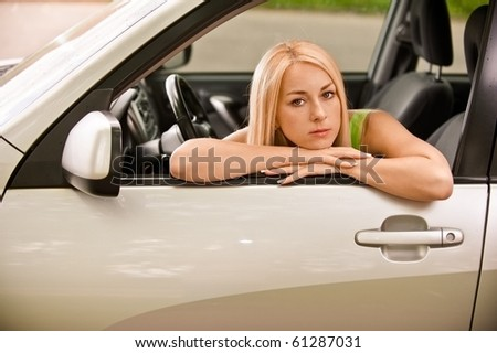 Driver-woman of car at wheel rest.