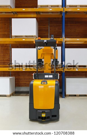 Driverless forklift truck in modern automated warehouse