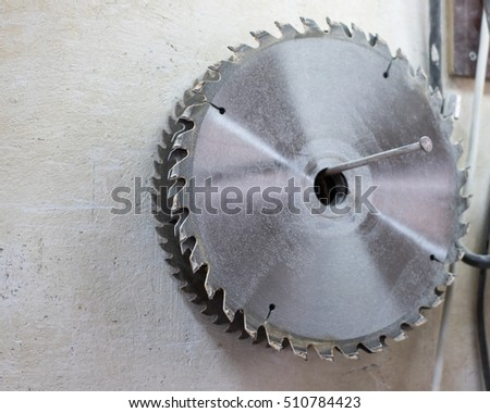 Drives for circular saw hanging on a nail on the wall