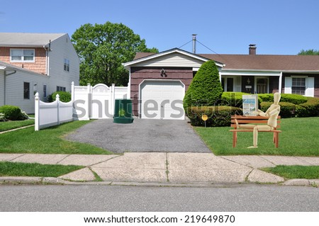 driveway entrance suburban home residential neighborhood USA clear blue sky - stock photo