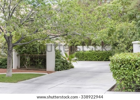 driveway in front of upscale suburban house