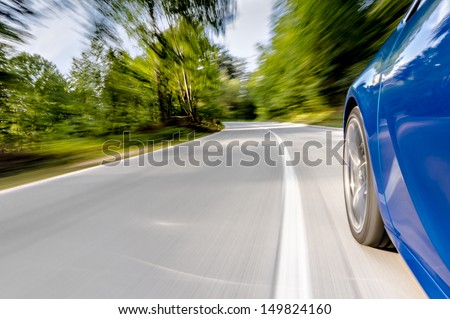 Driving a car in a curve - stock photo