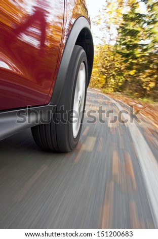 Driving a car in the autumn