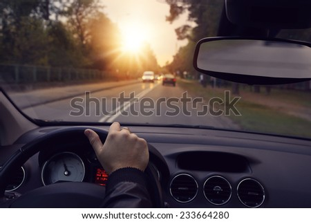Driving a car in the city streets - stock photo