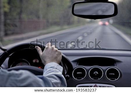 Driving a car on empty street