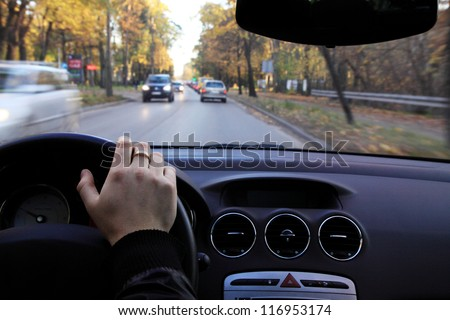 Driving a car on small road - stock photo