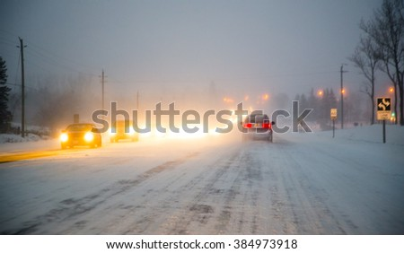 Driving an Icy Winter Roadway - stock photo