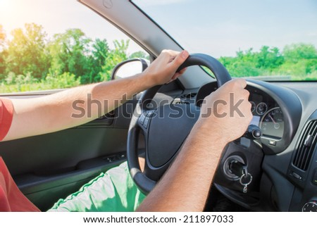 Driving and holding the steering wheel.
