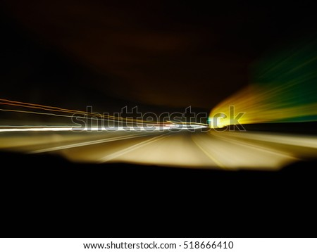 Driving at night scenery with colorful blurred lights background