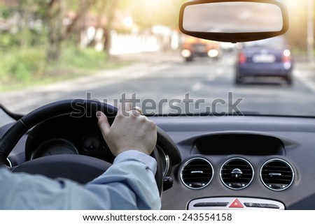 Driving car in the sunny streets of the city