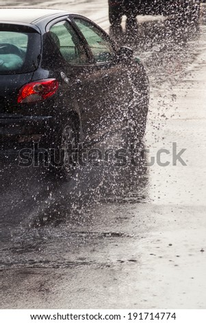 driving car on a wet street - stock photo