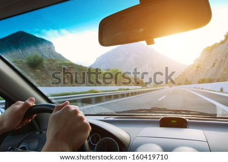 driving car on the mountain road - stock photo