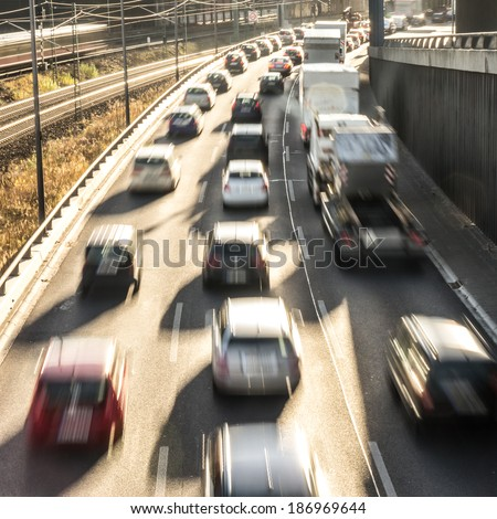 driving cars on a highway - stock photo