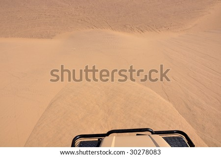 Driving down the sand dunes on Skeleton coast in Namibia - stock photo