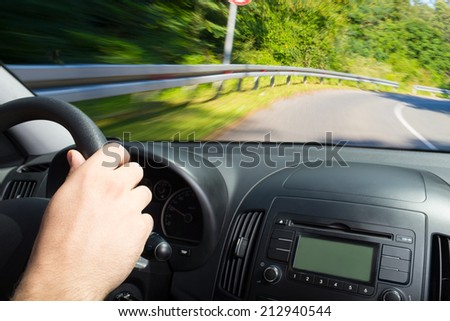 Driving fast and heading to crash in opposite lane. - stock photo