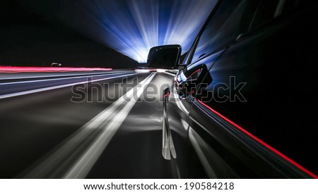 driving fast on german autobahn, rigged camera on side of a german black car during night, bulb exposure - time-lapse, special effect photography - stock photo