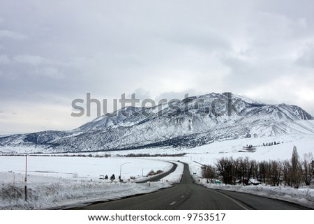 Driving Hwy 395 near Mammoth Mountain in the eastern Sierra Nevada mountains of California after a heavy winter storm.