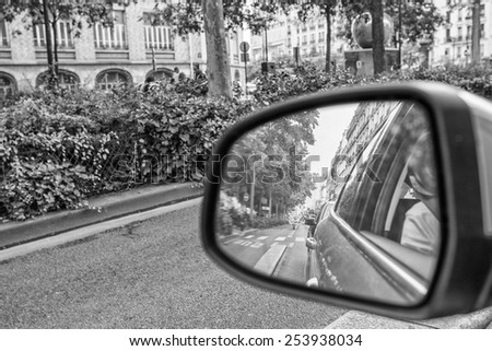 Driving in a big city. Rear mirror view. - stock photo