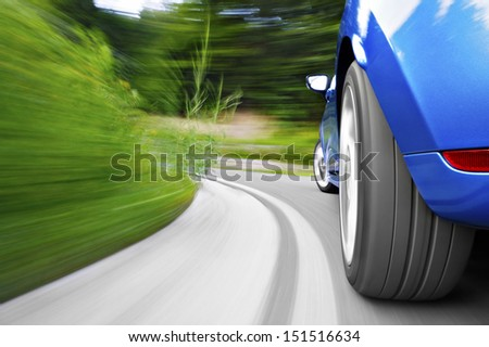 Driving in a curve - stock photo