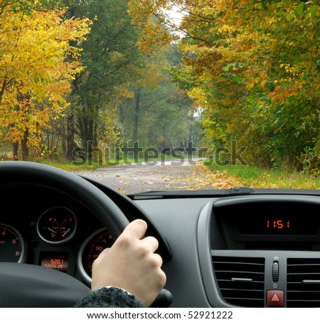 Driving in fall - stock photo