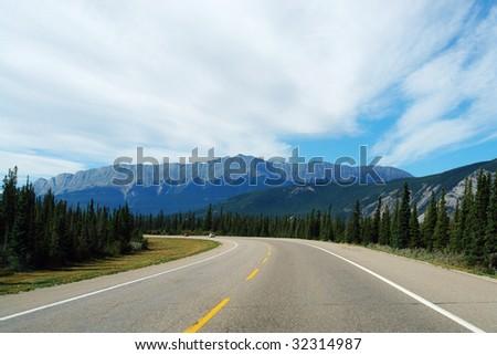 Driving in mountain road at jasper national park, alberta, canada - stock photo