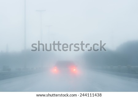 driving in the fog  - stock photo