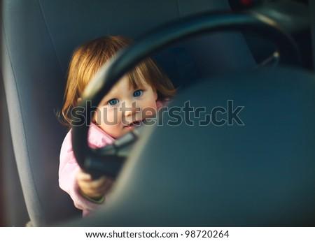 Driving little girl - stock photo