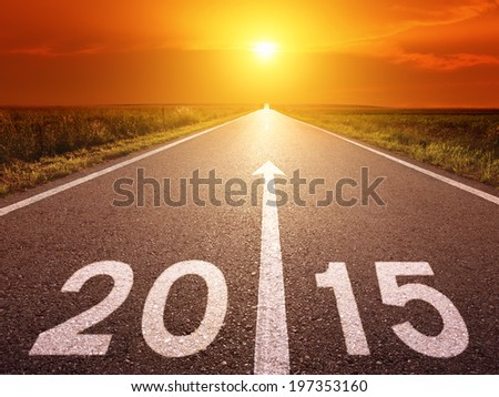 Driving on an empty asphalt road forward to new year - stock photo