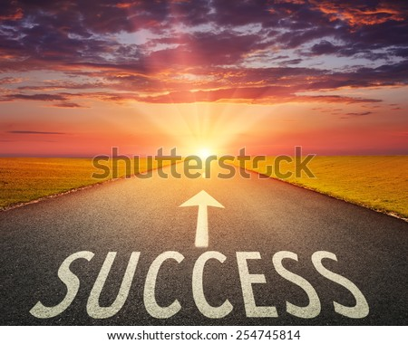 Driving on an empty asphalt road towards the setting sun and sign which symbolizing success. Concept for success. - stock photo