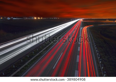Driving on highway at night near Belgrade - Serbia. Llight trails on motorway at night, long exposure abstract photograph. - stock photo