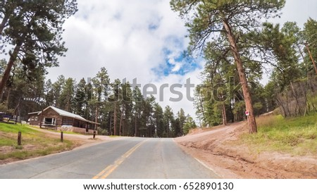 Driving on small paved road in rural mountain area.