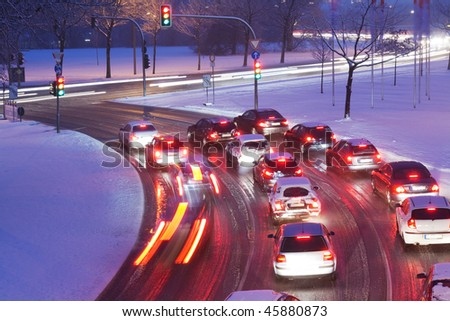 Driving on snowy road - stock photo