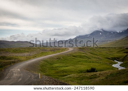 Driving on the road in the remote and wild Westfjords of Iceland
