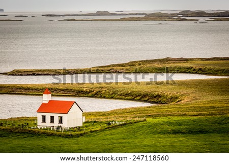 Driving on the road in the remote and wild Westfjords of Iceland. Lonely Church in the landscape   - stock photo
